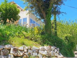 Rez de Villa au centre de Sartene avec terrasse et jardin