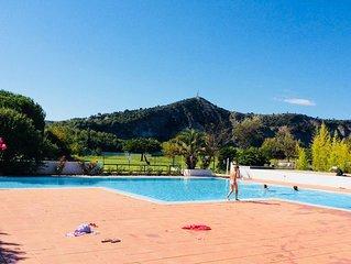 Joli appartement climatise jardin privatif grande piscine