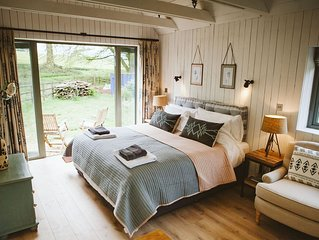 Stylish converted Barn in the grounds of a Georgian Lodge House in South Downs.