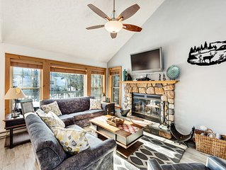 Warm and cozy home with mountain views, a fireplace, and a deck!