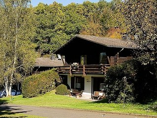 Tidy chalet with fireplace, located in wooded area