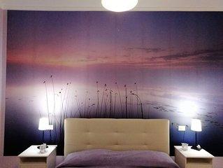 Raffinato appartamento con camere dotate di bagno.
