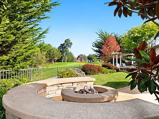 Bright, luxurious home w/ an outdoor fire pit, gas grill, & golf course view
