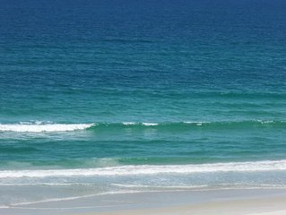 Watch the Dolphins play in the Atlantic while the gentle waves roll in.