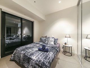 A Ritzy 2BR CBD Apartment with a Pool & Gym