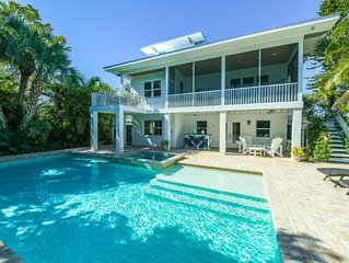 Beautiful Canal front home, 1 block to BEACH! 5 Bedrooms, Pool, Spa, & Game Room