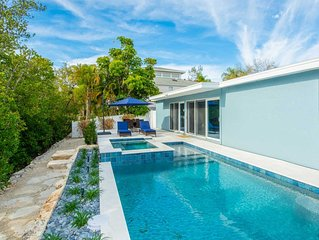 Luxury 3 bedroom beach bungalow with pool and spa! Canal front with dock!