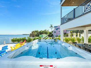 Fantastic Water Front Luxury home! Dock, A+ views, SwimSpa, and near the beach!