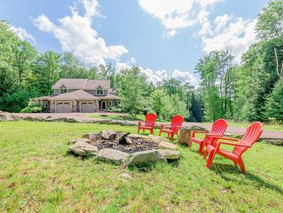 Lake area home with hot tub, gas grill, fire pit, and game tables!