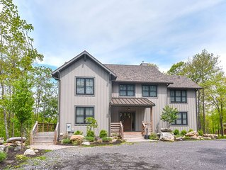 Dog friendly home with 5 master suites, a hot tub and game room!