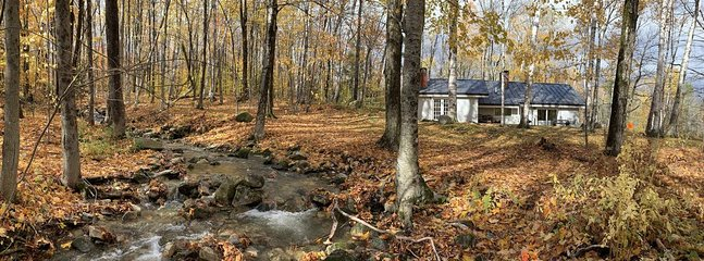 Brook adjacent to West side of house; you can hear the water from the master bedroom