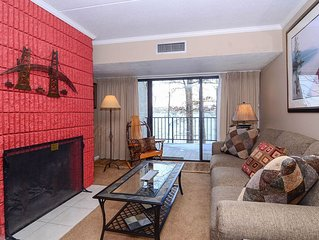 207B- Unique one bedroom lakefront condo w/ 2 queen beds and 2 fireplaces!