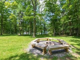 Lakefront home with dock slip, hot tub, sauna, gas grill and fire pit!