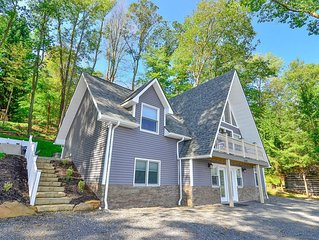 Split lakefront home with private dock, hot tub, pool table and fire pit!