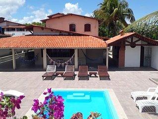 Casa de praia com piscina, churrasqueira, redes e área de lazer de 1350m2
