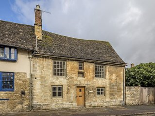 The Cottage is Grade II Listed, built from honey-coloured Cotswold Stone.