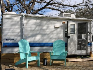 Sleep among the pines. Camper with Deck and Firepit. Close to ZDT Amusement Park
