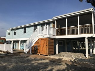 Steps from beach access, water view, completely remodeled!