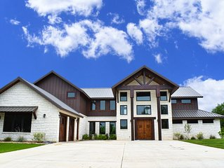 Largest Luxury Home in the Concan Golf Course with hot tub! Sleeps 27 guests