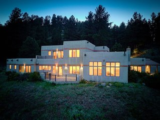Amazing mountain home on 126 acres bordering national forest land
