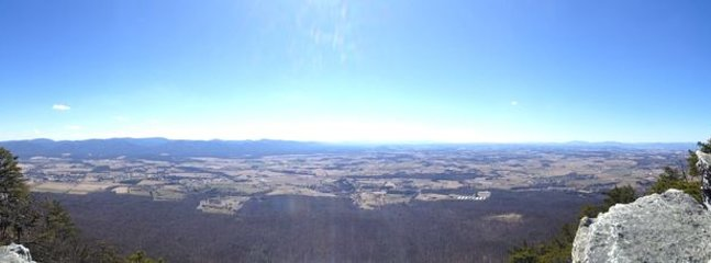 panoramic view of valley from hang gliding platform at the top of the ski slopes