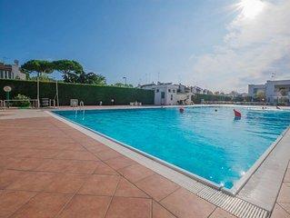 VIlletta trilocale con giardino in residence con piscina, terrazzo con barbecue