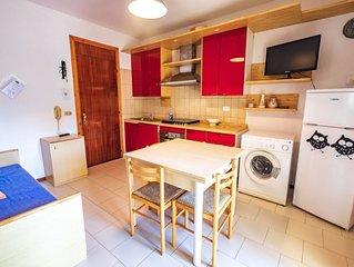 Appartamento trilocale in residence con piscina, aria cond. e lavastoviglie