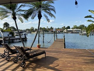 WATERFRONT PARADISE W/BOAT DOCK AND SWIM SPA WITH SURROUNDING BAR.