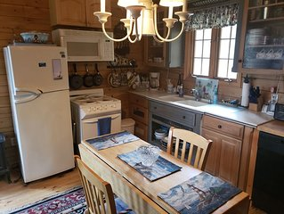C.E.M. Vacation Rentals - The Lighthouse coastal Log Cabin