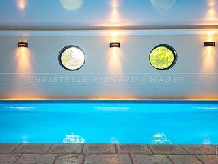 Maison avec grande piscine couverte et chauffée