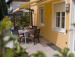 Beautifully furnished, two-bedroom home with sunny terrace.