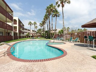 Remodeled Condo 1/2 block from beach with pool and hot tub!