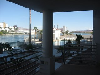 Riverfront Condo with Dock, Pool, Jacuzzi, and Casino View's