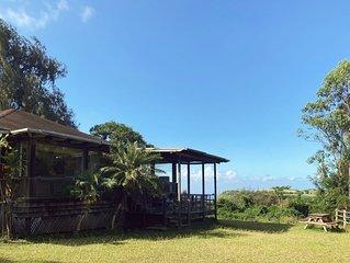 Rustic retreat with panoramic views, tropical gardens, & biodynamic produce!