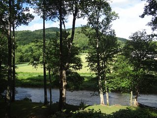 LOG CABIN with DIRECT ACCESS TO WATAUGA RIVER & MOUNTAIN VIEW.