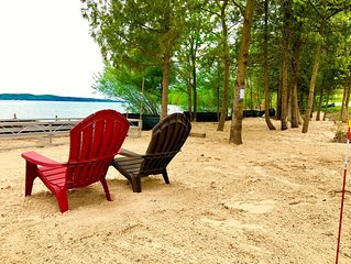Hillside Hideaway with 154 ft. private beach on the south shore of Suttons Bay