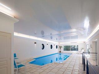 Maison avec grande piscine couverte et chauffee