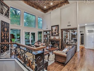 Stunning custom home sited on very private lot with pool/spa