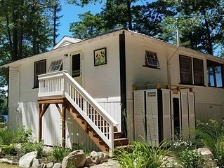 Adorable cottage set among tall pines with sandy beach only .5  mile from town.