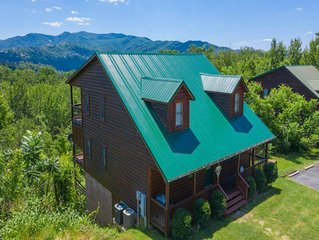 Take in panoramic mountain views in this  3 BR/3 BA log chalet with all the amen