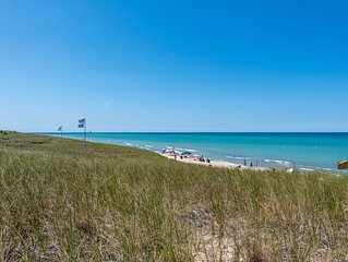 Steps Away from Mile Long Michigan Lake Beach! Wi-Fi