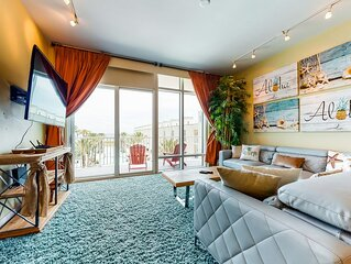 New listing! Waterfront condo w/ shared pool, hot tub, gym, & beach access!