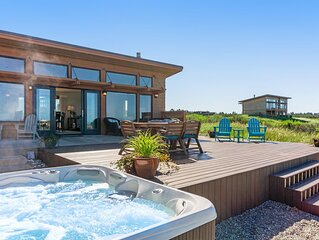 Family-friendly, oceanfront beach home w/ a private hot tub & ocean views!