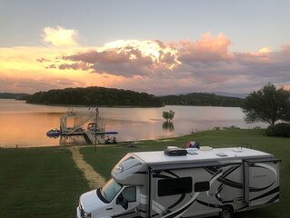 Lakefront RV rental with access to boat dock and launch in backyard
