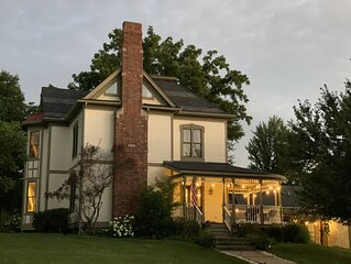 Completely restored 1885 Queen Ann style home located next to the temple lot