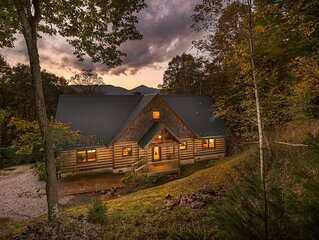 The Dream Cabin true log home indoor-outdoor fireplace family friends reunion