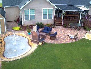 Basement apt and fenced back yard with deck, patio, fireplaces and splash pad
