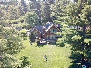 Beautiful lakeside home with private beach, access to golf, skiing, shopping