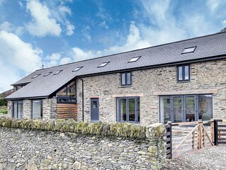 Get away in style at this stylish cottage in beautiful Mid Wales countryside. Co
