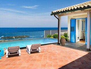 Private seafront villa with swimming pool